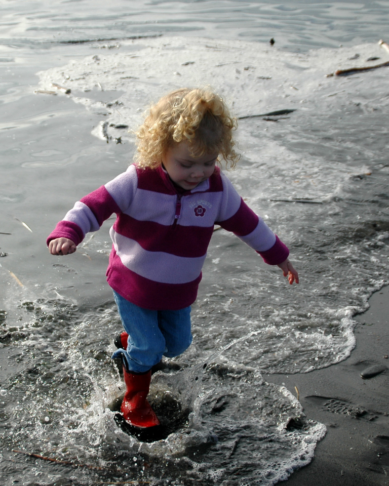 Laurel splashing in the ocean